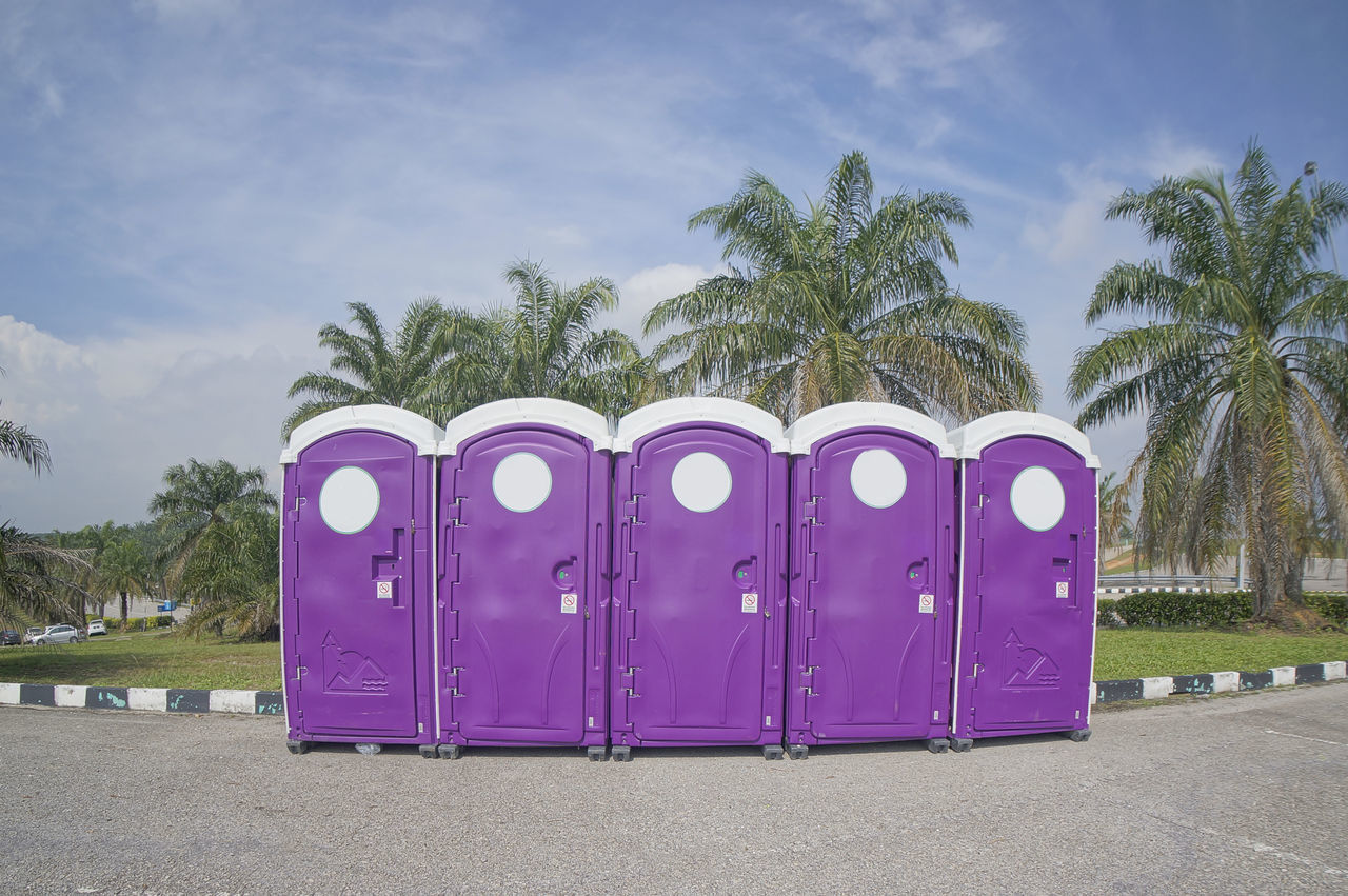 a row of portable toilets public convenience Clouds Convenience Grass Portable Toilets Sky Tarmac Toilet