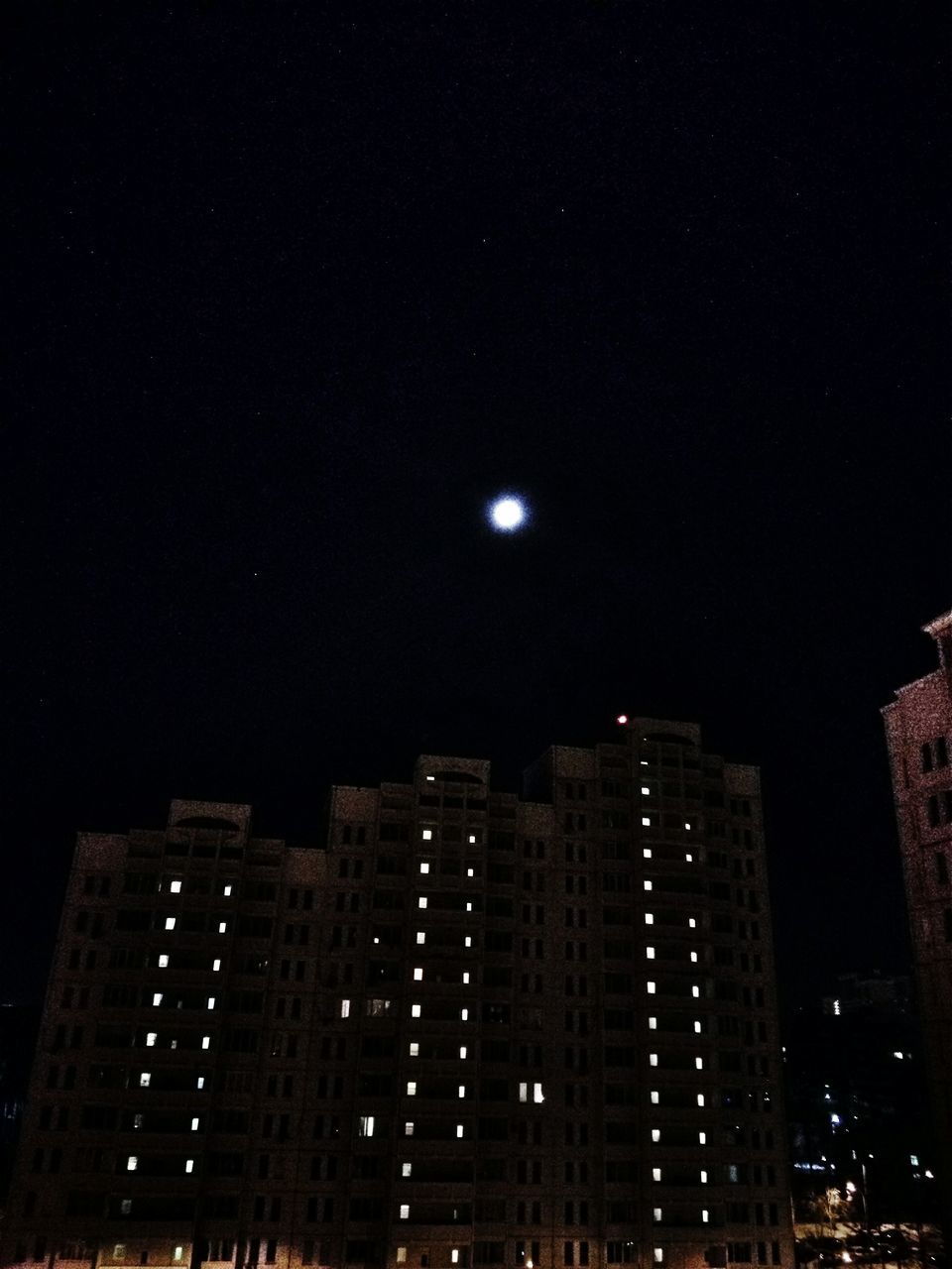 night, architecture, building exterior, illuminated, moon, built structure, city, skyscraper, modern, no people, low angle view, outdoors, sky, cityscape