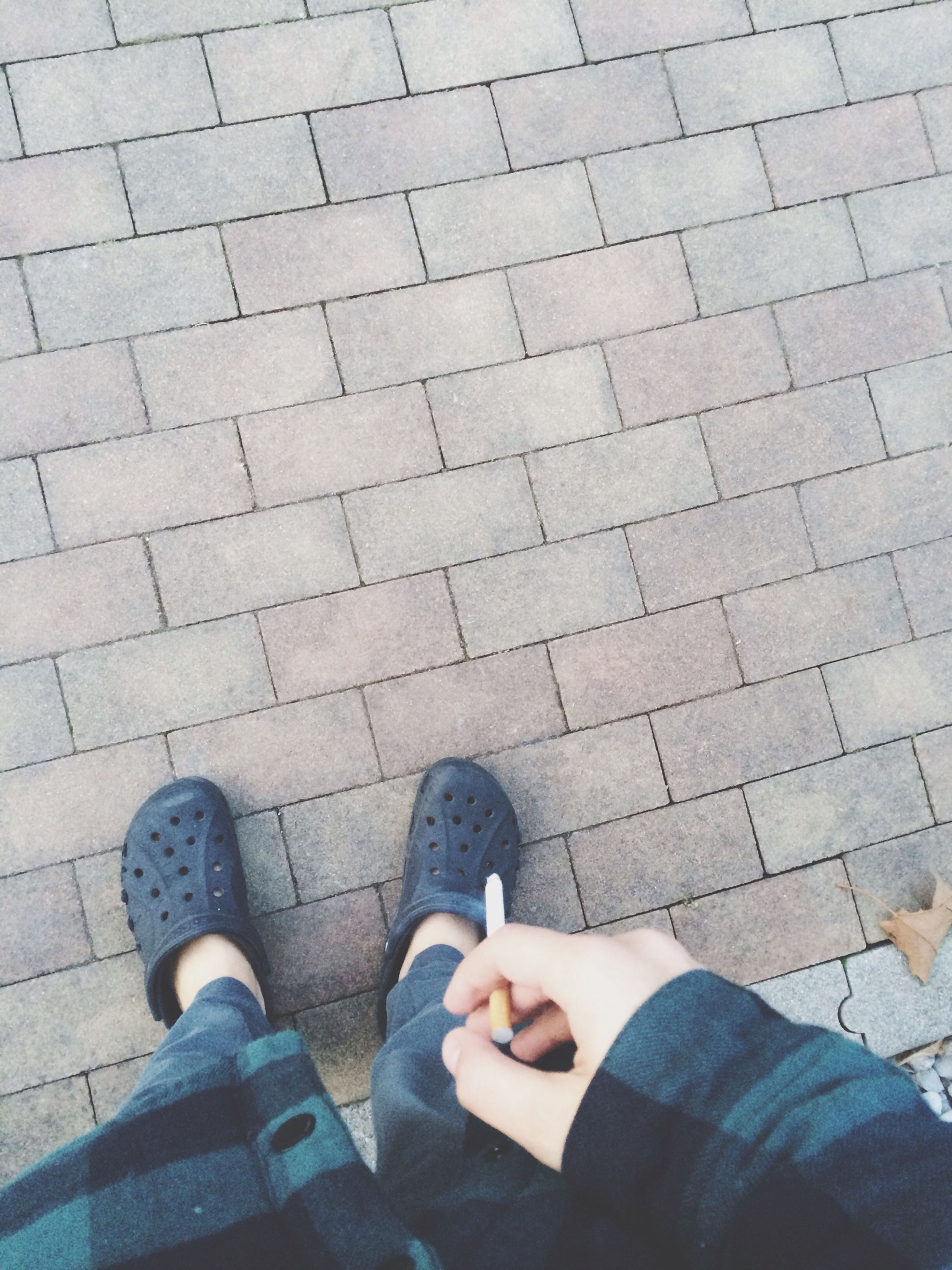 low section, person, shoe, personal perspective, high angle view, standing, footwear, lifestyles, human foot, directly above, leisure activity, men, cobblestone, street, paving stone, footpath