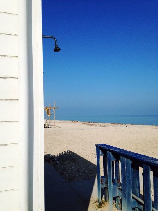 Beach Hut Blue Clear Sky Sea Beach Sunlight Day Outdoors Sand Nature Built Structure No People Horizon Over Water Water Architecture Vacations Beauty In Nature Sky Lifeguard Hut