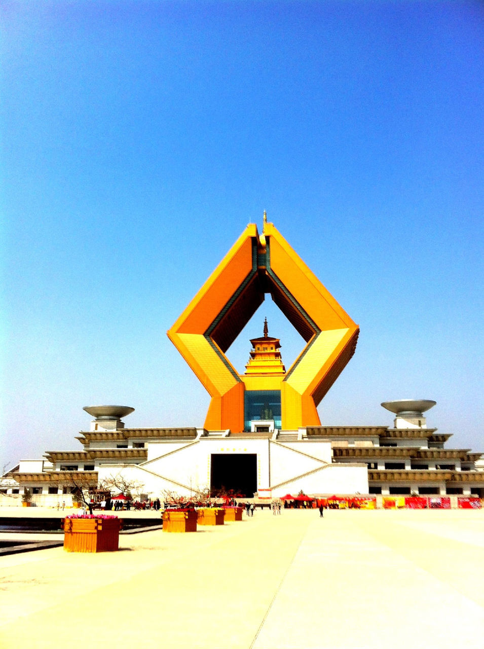 Yellow architectural structure against clear blue sky
