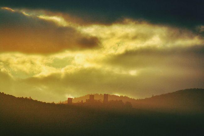 The evening mist Silhouette Cloud - Sky Sunset Sky Beauty In Nature Majestic Mountain Range Buildings & Sky Scenics Outdoors Dark Cloudy