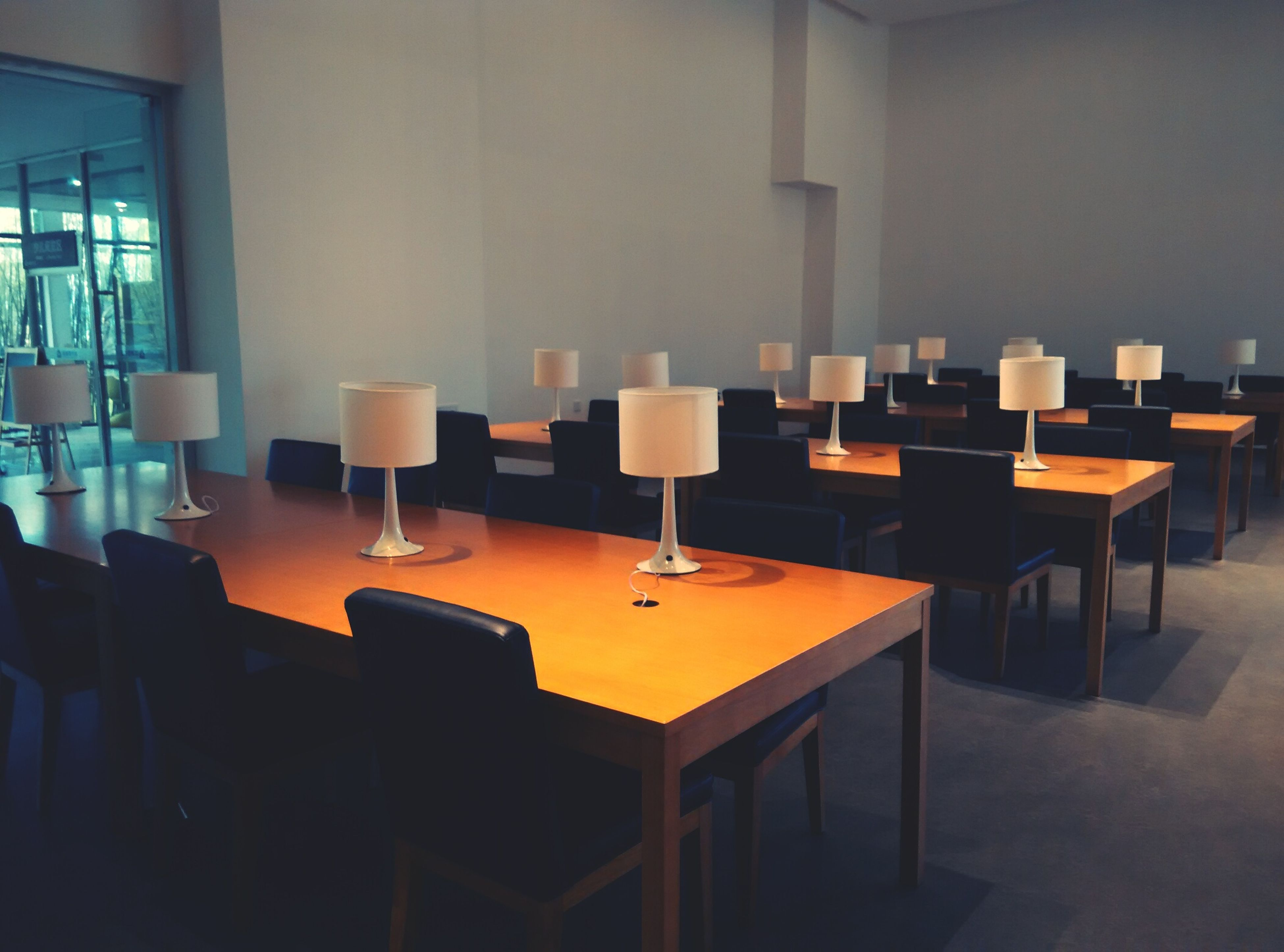 indoors, illuminated, chair, table, absence, empty, home interior, lighting equipment, room, in a row, restaurant, furniture, arrangement, no people, interior, shelf, domestic room, large group of objects, electric lamp, window