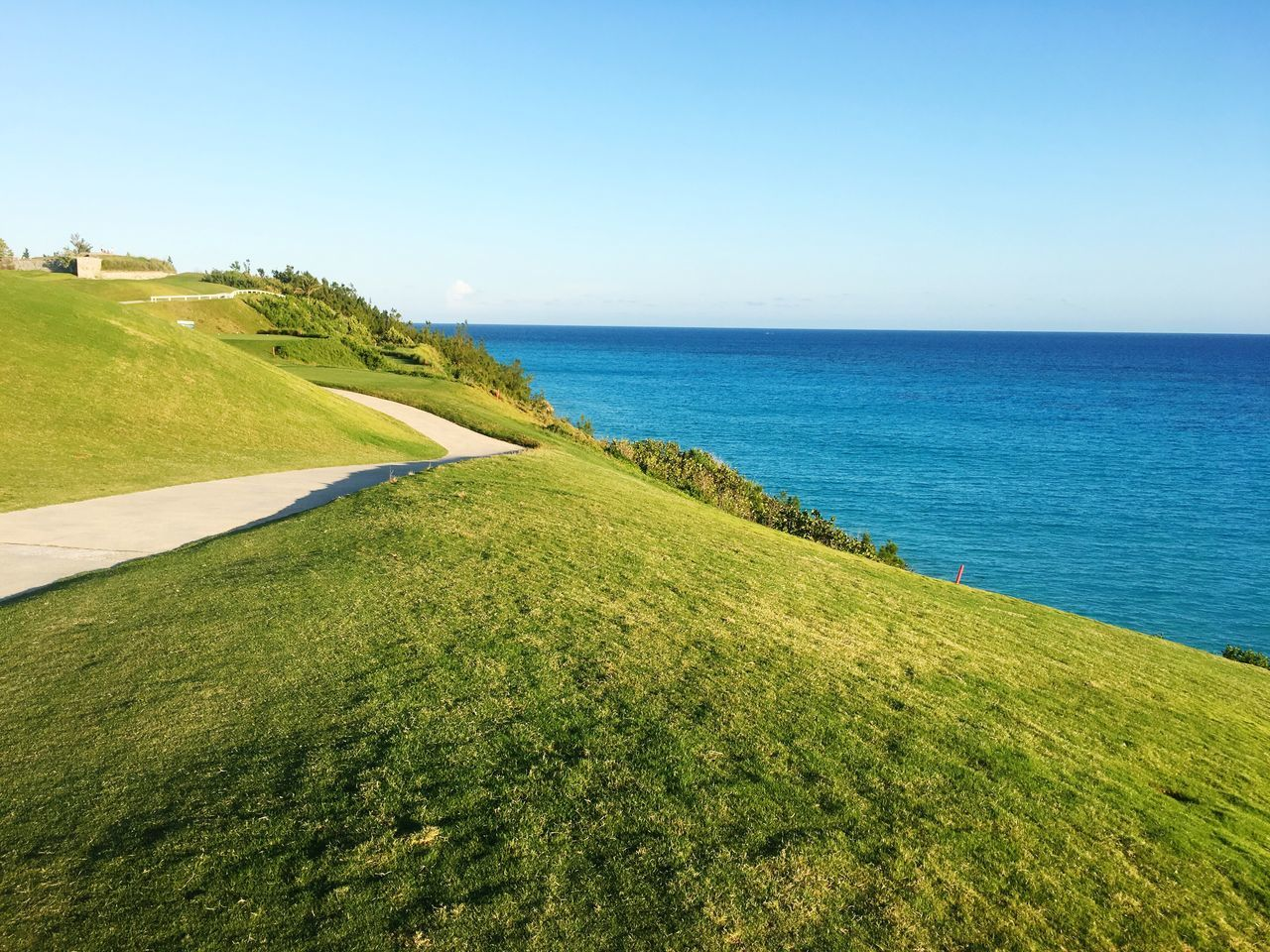 Sea Tranquil Scene Scenics Nature Clear Sky Water Tranquility Horizon Over Water Grass Green Color Beauty In Nature Beach Day Blue No People Outdoors Sky Golf Course Golf Club