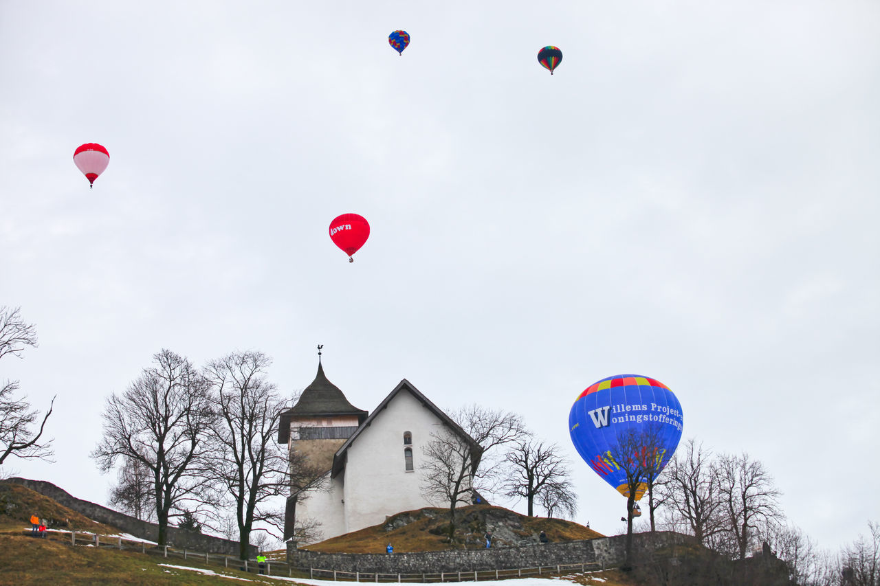 International hot air balloon festival at Chateau d' Oex, Switzerland Air Annual Balloon Basket Château Cold Colorful D' Oex Festival Fire Flying High Hot Participant Passenger Shape Snow Swiss Swiss Alps Switzerland Winter