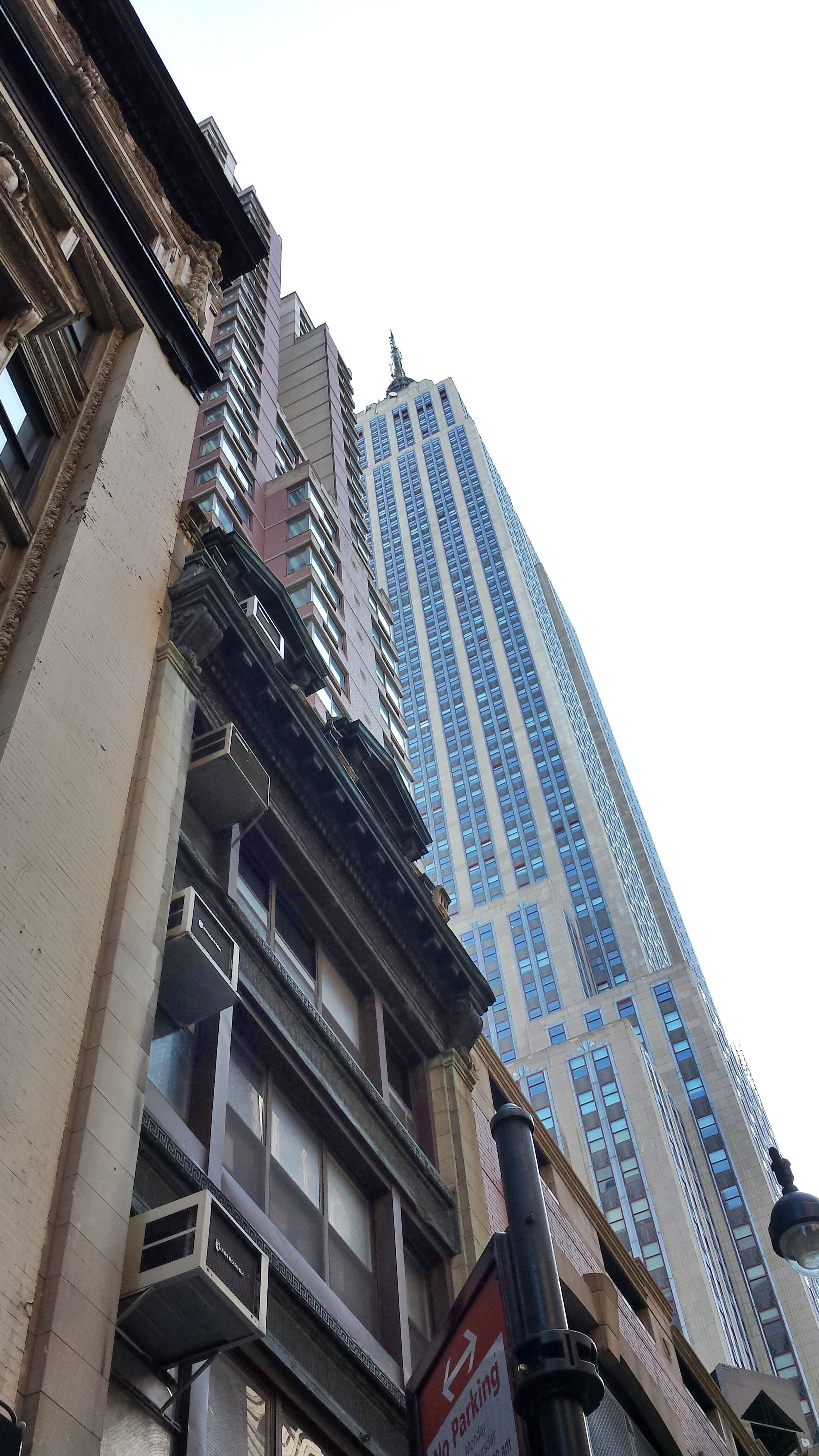 architecture, building exterior, built structure, low angle view, clear sky, city, building, residential building, window, residential structure, tall - high, office building, sky, tower, modern, skyscraper, outdoors, day, apartment, city life