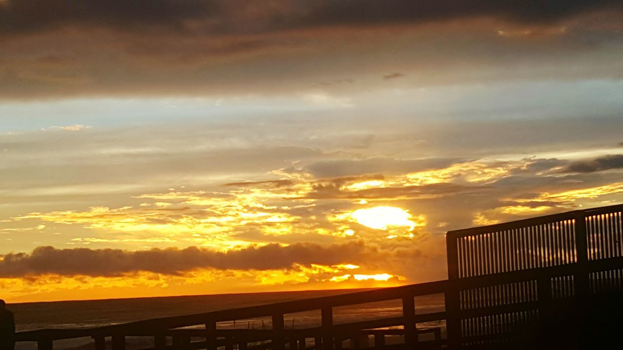 sunset, railing, sky, cloud - sky, orange color, sun, nature, no people, scenics, bridge - man made structure, beauty in nature, outdoors, sunlight, day