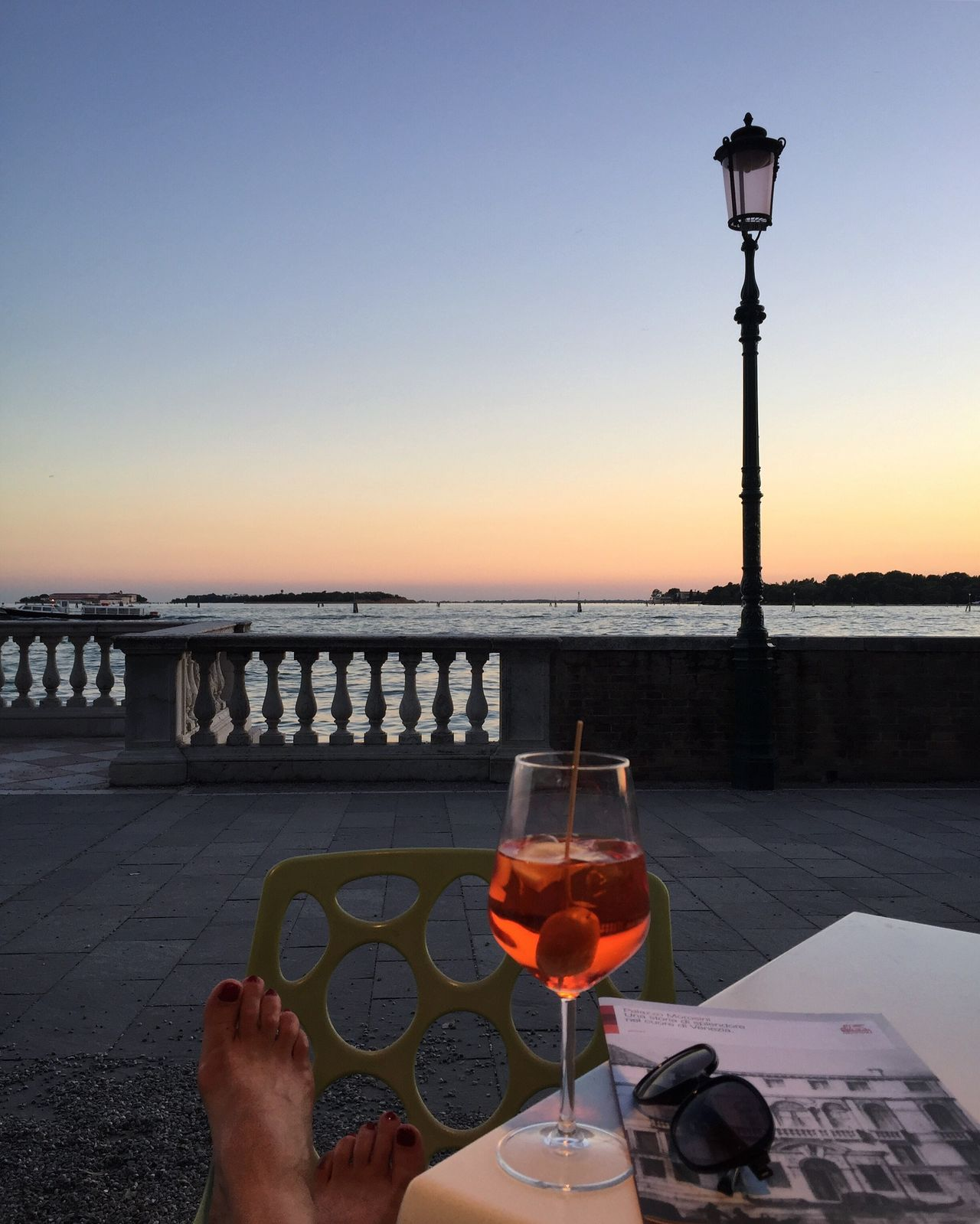Aperol and me in Venice Wineglass Sunset Real People Water Sea Clear Sky Drink Wine Food And Drink One Person Outdoors Men Sky Human Hand Alcohol Human Body Part Lifestyles Nature Women Horizon Over Water Spritz Aperol Aperitivo  Italy Venice