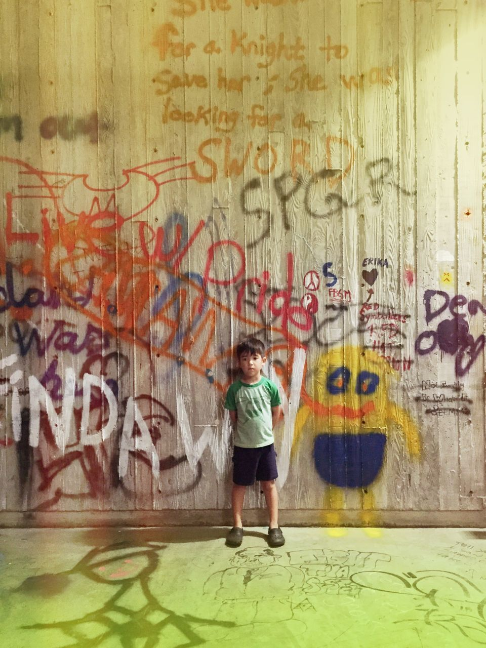 graffiti, full length, text, casual clothing, one person, childhood, built structure, standing, day, architecture, children only, outdoors, people