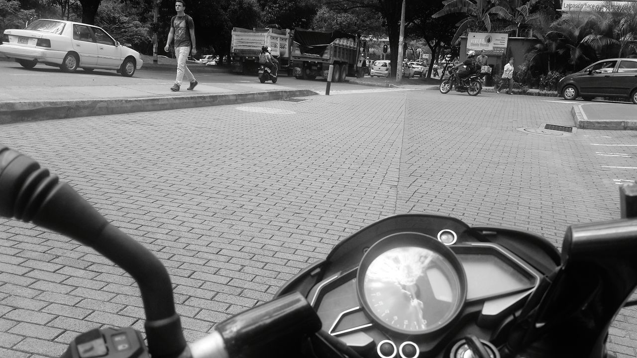 transportation, land vehicle, mode of transport, car, street, road, day, outdoors, motorcycle, sidewalk, stationary, real people, city, scooter, close-up