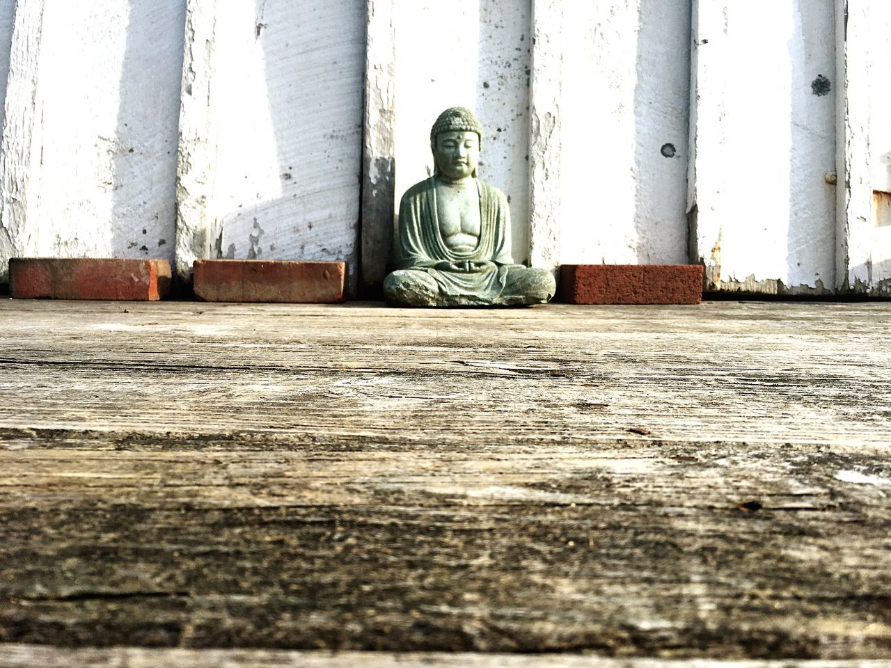 religion, human representation, statue, spirituality, sculpture, male likeness, built structure, day, architectural column, ancient, place of worship, indoors, architecture, ancient civilization, no people, close-up