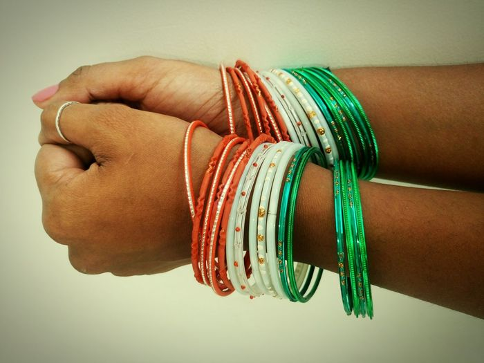 Human Hand Jewelry Human Body Part Adults Only Men People Ring Adult Celebration One Person Life Events Women Indoors  Ceremony Close-up Bangle Day Indian Culture  Republic Day 26 January Republic Day Independence Day Indian Flag White Color Orange Color Green Color