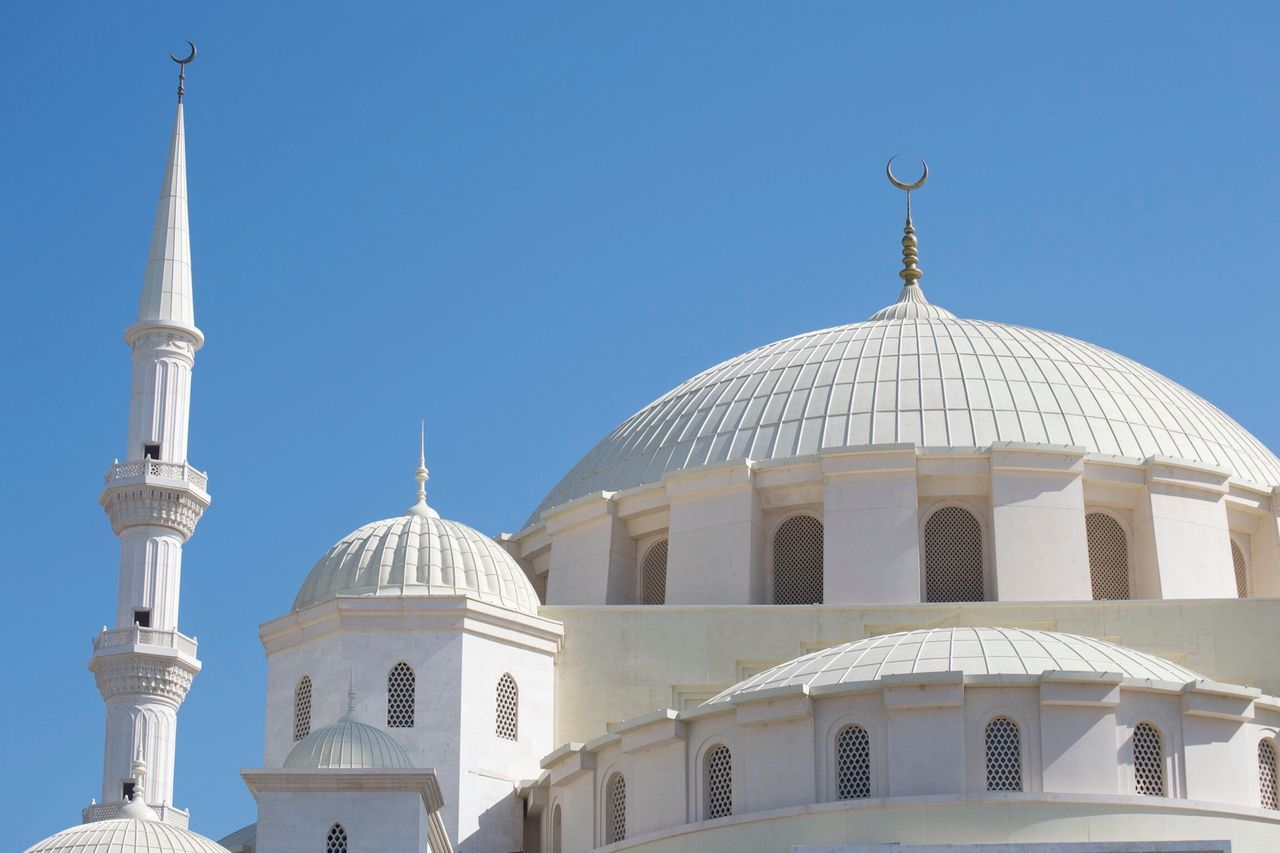dome, religion, architecture, place of worship, spirituality, built structure, building exterior, clear sky, travel destinations, day, low angle view, outdoors, blue, no people, sky