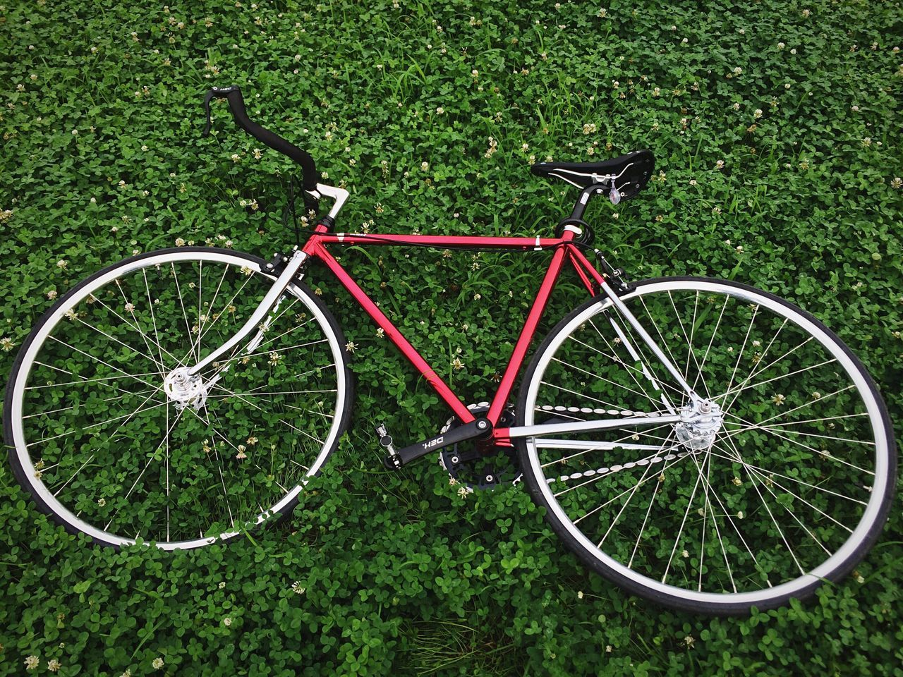 High Angle View Of Bicycle On Green Field With Plants