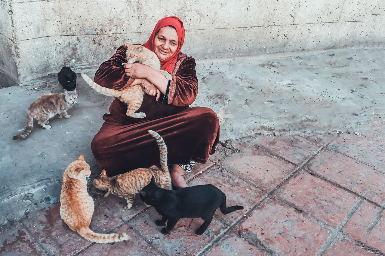this kind women comes daily to this spot in the street at the same time to feed stray cats , i asked her for a photo n she agreed :) took it at old cairo Adult Alley Cat Animal Themes Cat Check This Out Day Domestic Animals Exceptional Photographs Eye4photography  EyeEm Best Shots Full Length Livestock One Animal One Person One Woman Only Only Women Outdoors People Pets Popular Photos Sitting Stray Cat Street Photography Streetphotography Women Around The World