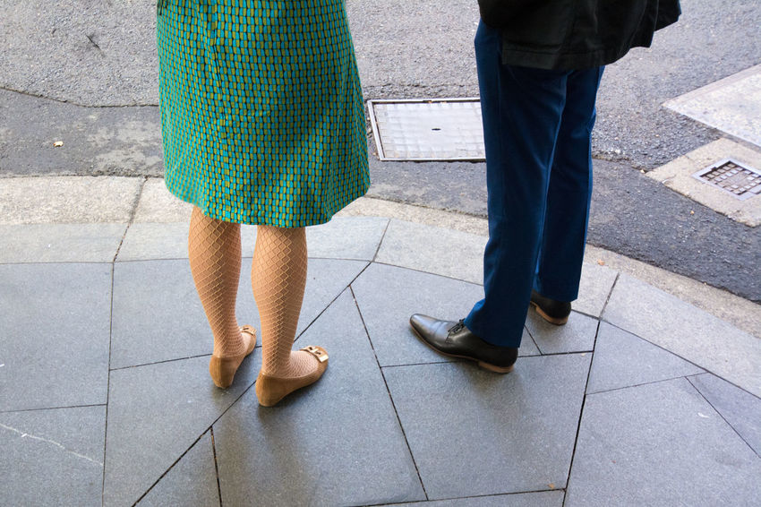 Lower body section / legs of a man and woman in business clothing standing on a street. Adult Business Clothing Business People Business Person Day Dress Human Body Part Human Leg Legs Low Section Nylons Outdoors People Standing Stockings Suit Two People