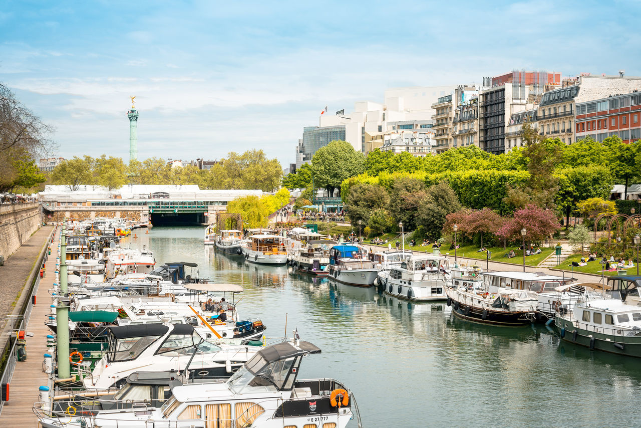 Architecture Bastille Bridge - Man Made Structure Building Exterior Business Finance And Industry Cityscape Day Horizontal Mode Of Transport Moored Multi Colored Nautical Vessel Outdoors People Reflection Reflection Lake Sky Tourboat Tourism Transportation Travel Destinations Tree Urban Skyline Water Yacht