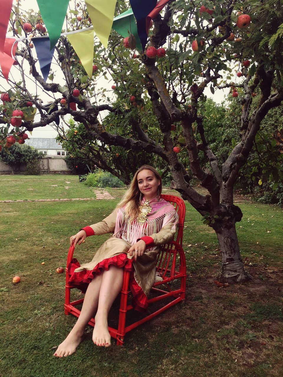tree, sitting, young adult, full length, one person, young women, real people, beautiful woman, outdoors, park - man made space, day, lifestyles, grass, smiling, nature, one young woman only, people