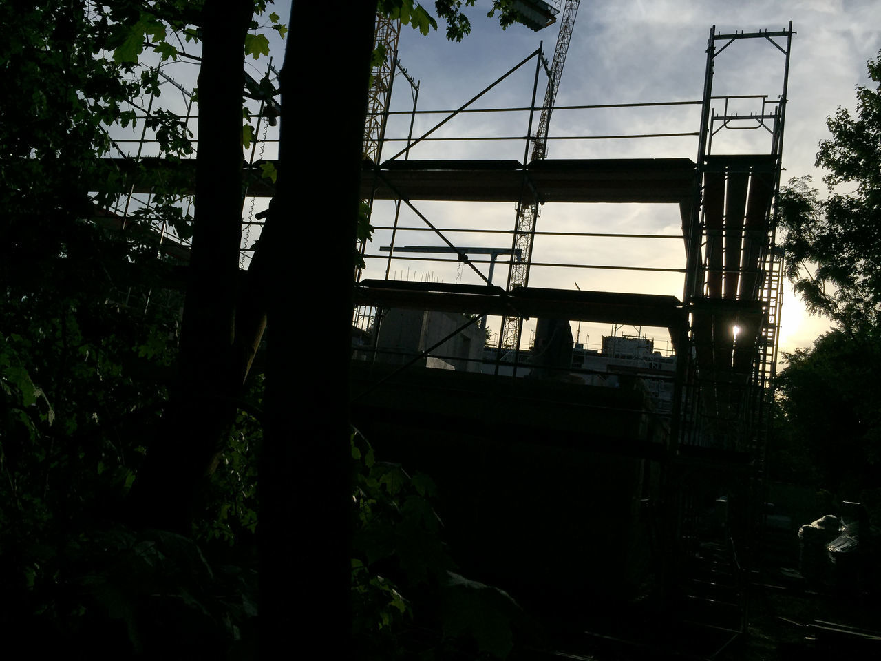 construction area in the evening Berlin Building Lot Building Site Construction Area Construction Site Eve Evening Evening Light Evening Sky Falsework Lot No People On Site Outdoors Scaffold Scaffolding Silhouette Site Sky Sky And Clouds Tree
