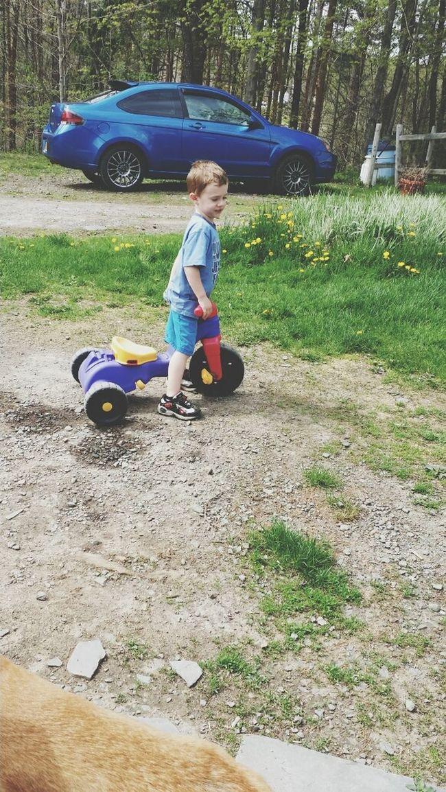 lilman riding his trike