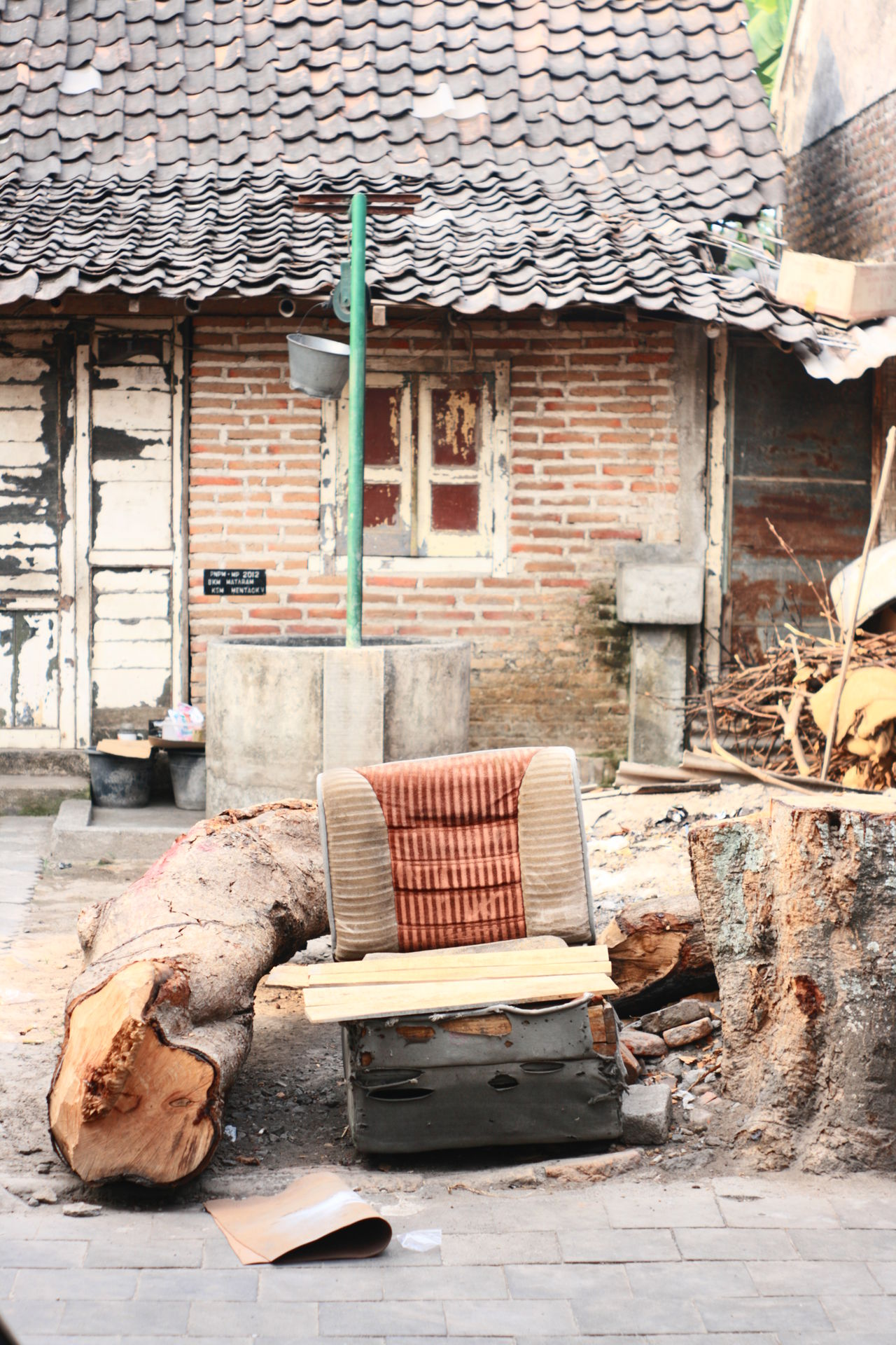 village in kota gede Architecture Authentic Authenticity Building Exterior Built Structure Couch Culture Day House Junk No People Outdoors Roof Tree Trunk Village BYOPaper!