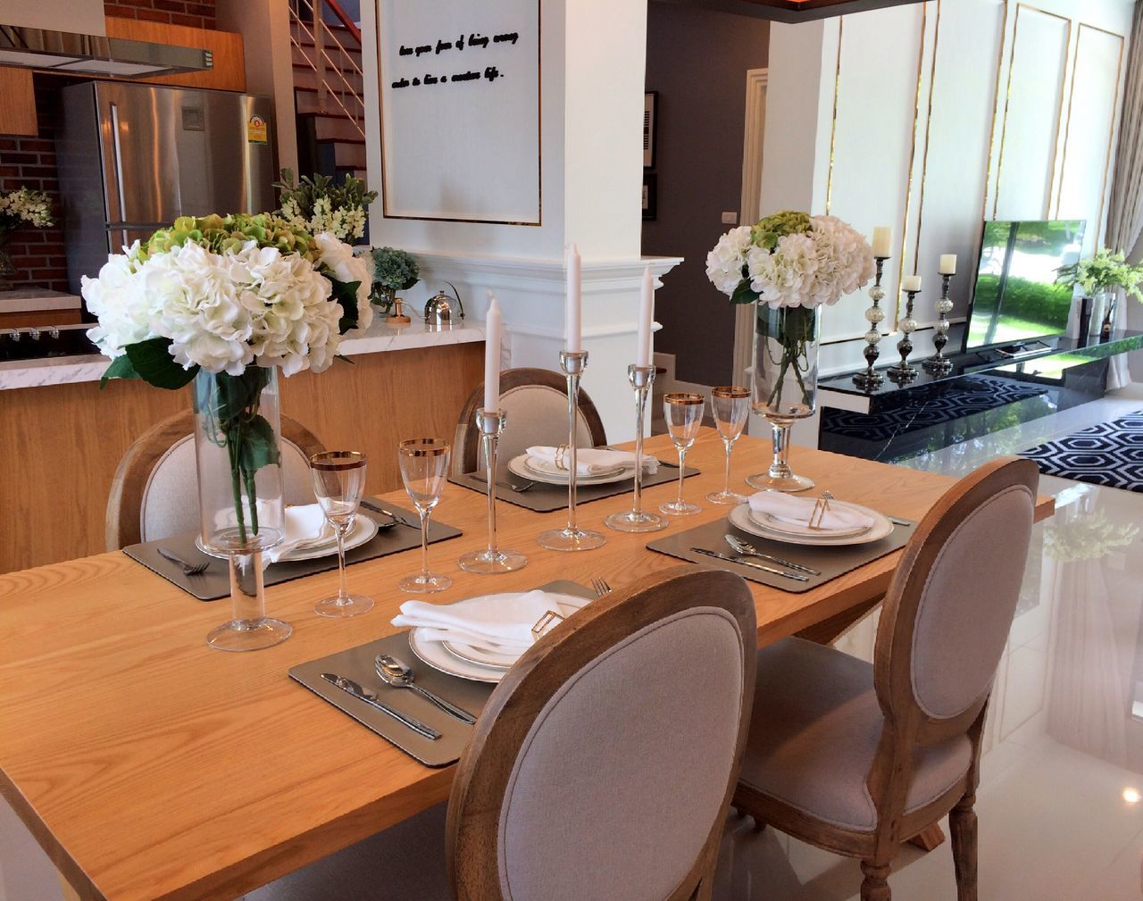 table, flower, vase, chair, place setting, dining table, indoors, plate, absence, bouquet, home interior, no people, dining room, day, cabinet, neat, wineglass