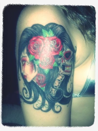this picture doesn't do my tattoo justice. my fav tat that i have(: