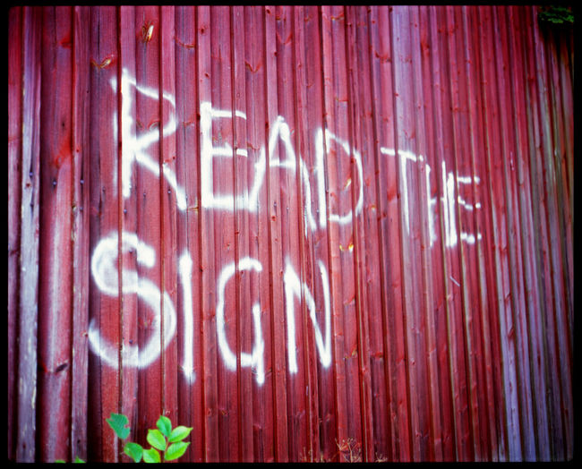Read the sign Abandonded Analogue Photography Båstnäs Forrest Graffiti Hut Imperative Message Message To The World Outdoors Plaubel Makina 67 Read The Sign Read The Sign Read!! Sign Slidefilm Sweden The Sign Trip Wooden Wall Word Graffiti Words Writing On The Walls Writing On Wood