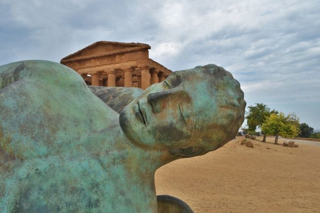 Agrigento Sicily Ancient Art Buddha Carving - Craft Product Cloud Cloud - Sky Cloudy Craft Creativity Day Famous Place History Monument No People Outdoors Sculpture Sky Statue Stone Material Temple - Building The Past Tourism Travel Destinations Valle Dei Templi