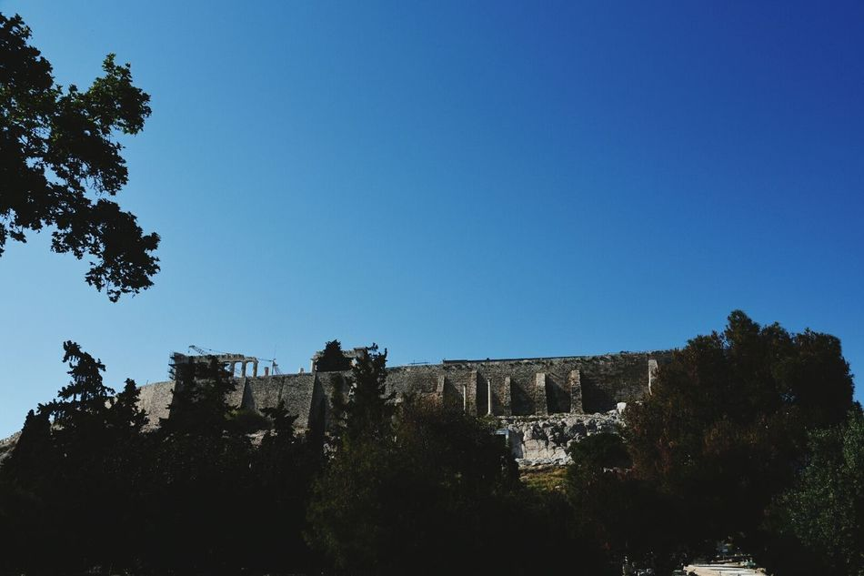 Tree History Travel Destinations Architecture Outdoors Day No People Sky Ancient Civilization Nature Parthenon Acropolis Greece Acropolis Museum Clear Sky Athens, Greece European Union Modern Architecture Wind Blue Patriotism