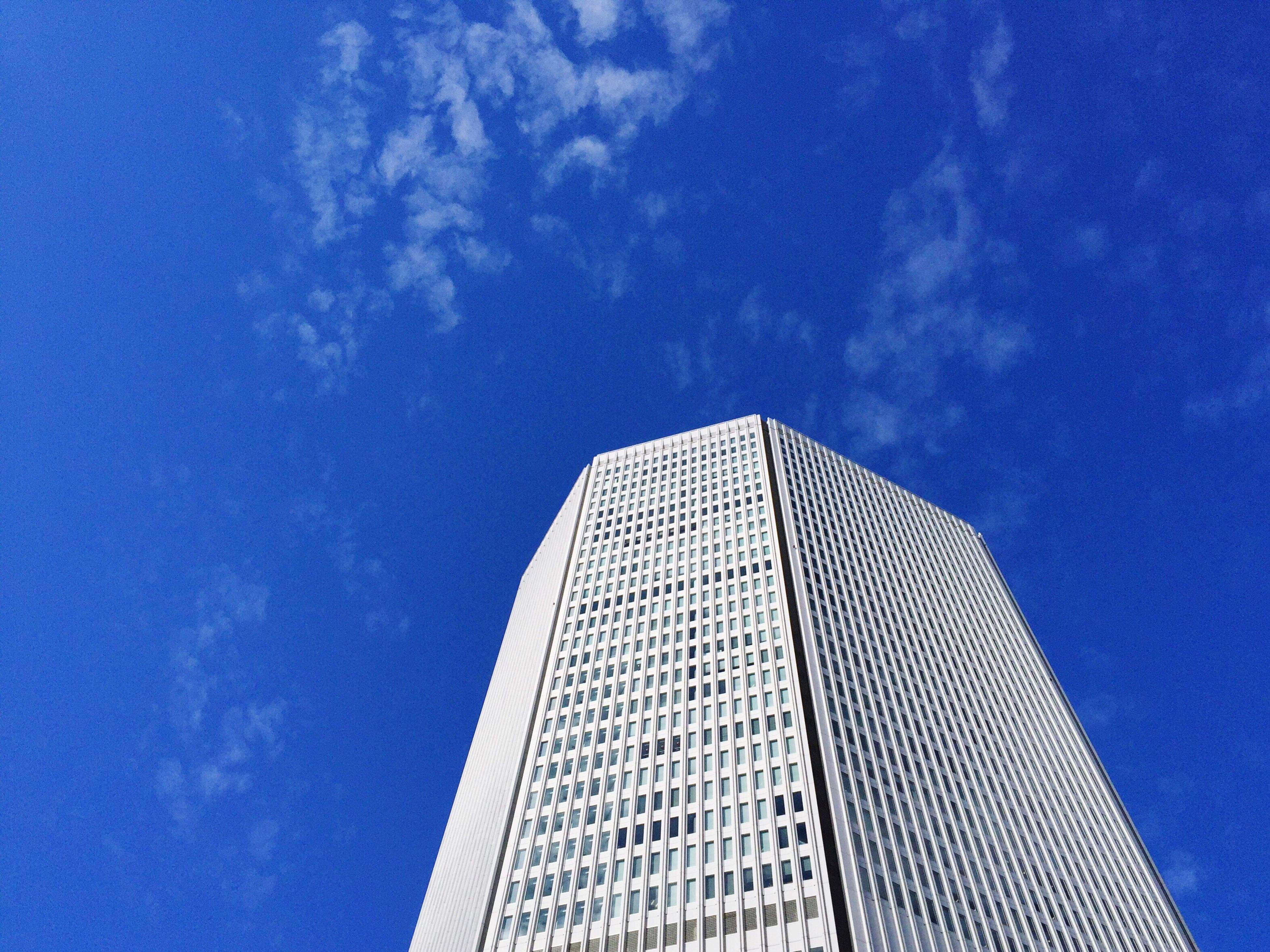architecture, low angle view, built structure, building exterior, sky, blue, no people, city, skyscraper, outdoors, growth, day, cloud - sky, nature