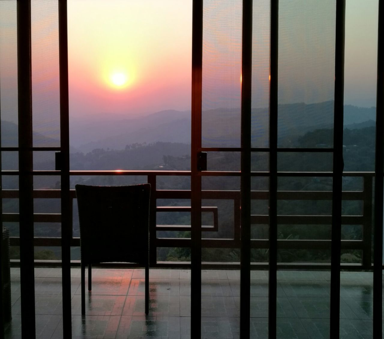 EyeEmNewHere Window Indoors  Nature Sky Home Interior No People Beauty In Nature Day Sunrise Outdoors Resting Time Relax Time  Alone Time Thinking Ahead Chilling Armchair Balcony View The City Light Lines And Lights Mountain View Mountain And Sunrise Sunlight, Shades And Shadows Emotions
