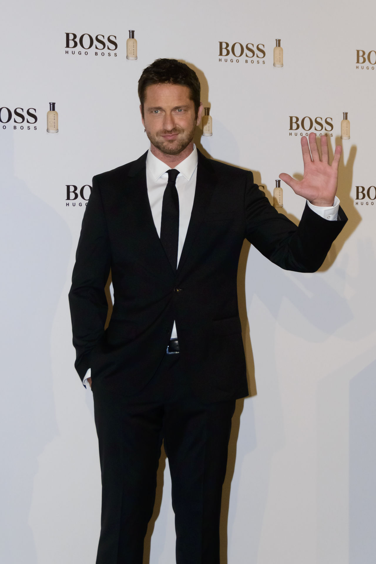 "The Scottish actor and producer, Gerard Butler, attended the Cocktail Hugo Boss photocall as ""Man of Today"" and Ambassador of Boss Bottled fragrances in Madrid, Spain. Actor Boss Bottled British Celeb Celebrity Editorial  Event Fashion Film Star Fragrance Front View Gerard Butler Hugo Boss Lifestyles Man Of Today Men Photocall Real People Red Carpet Scottish Standing Standing Vip Young Adult Young Men"