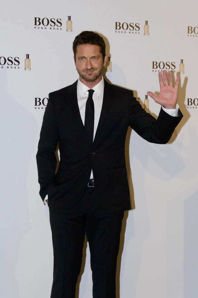"""The Scottish actor and producer, Gerard Butler, attended the Cocktail Hugo Boss photocall as """"Man of Today"""" and Ambassador of Boss Bottled fragrances in Madrid, Spain. Actor Boss Bottled British Celeb Celebrity Editorial  Event Fashion Film Star Fragrance Front View Gerard Butler Hugo Boss Lifestyles Man Of Today Men Photocall Real People Red Carpet Scottish Standing Standing Vip Young Adult Young Men"""