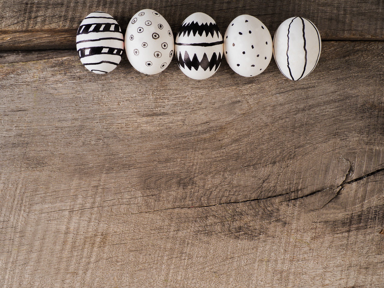 Some easter eggs hand drawn with black ink on a wooden table Backgrounds Black Celebration Celebration Event Creative Creativity Decor Decoration Decorative Do It Yourself Draw Drawn Easter Easter Cards Easter Eggs Easter Greetings Eggs Ideas Ink Painted Selfmade Spring Springtime Wood Woodden
