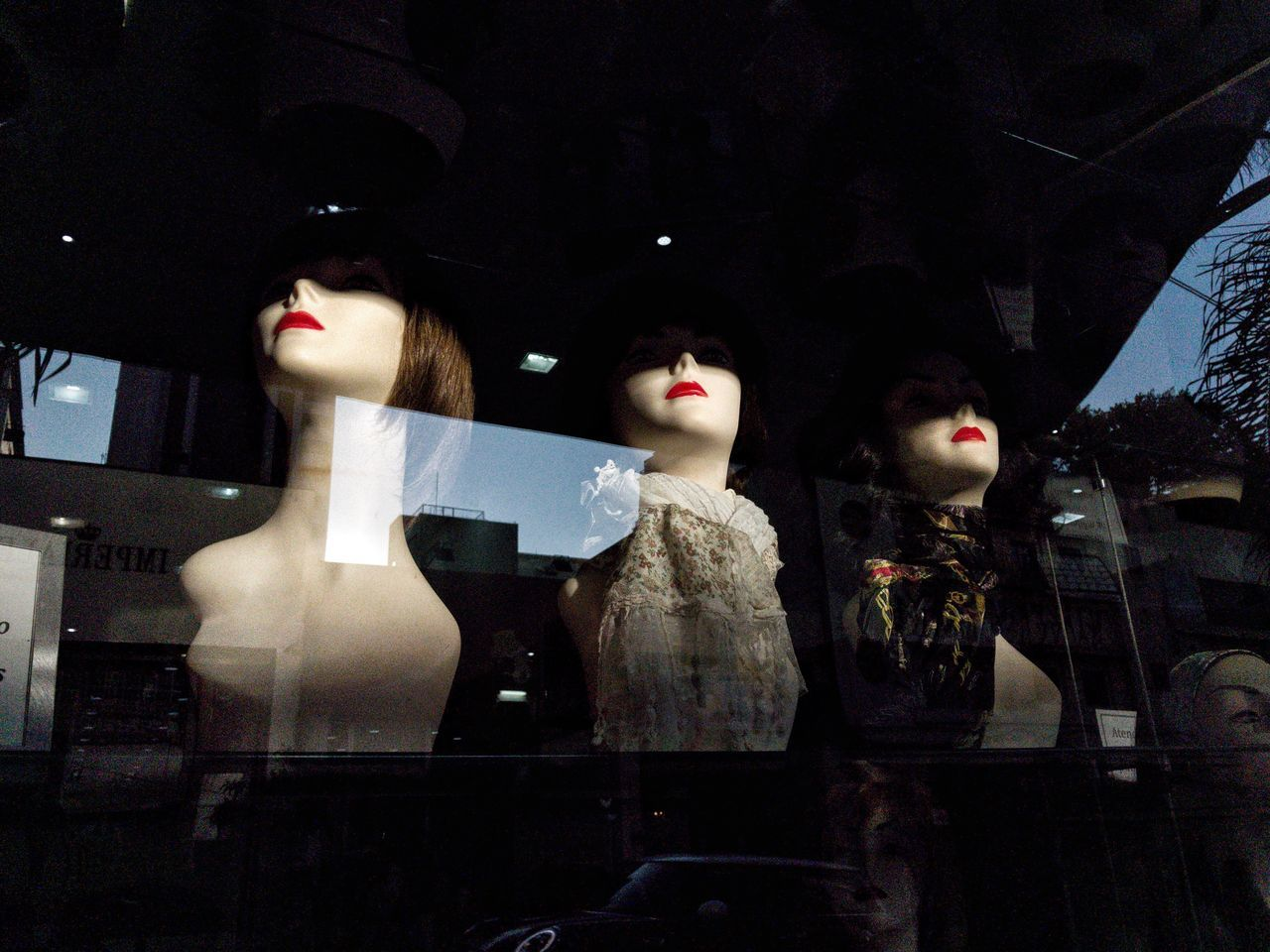 """""""Eyes wide shut"""". July, 2017 Streetphotography Store Mannequin Retail  Retail Display Human Representation Female Likeness Store Window Glass - Material For Sale Clothing Store Consumerism Fashion No People Boutique Indoors  Variation Doll Night Statue Business"""