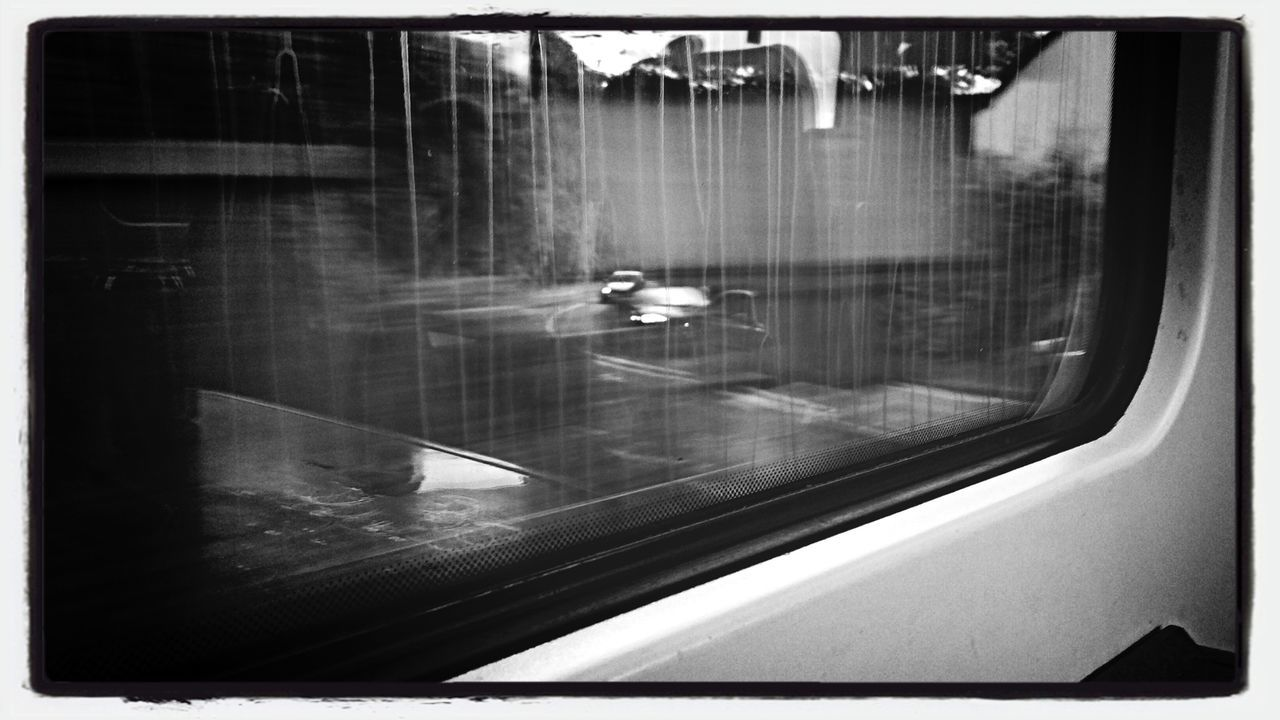Cropped Image Of Train Window