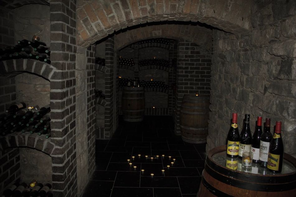 Kilronan Castle, Co Roscommon, Ireland, Wine Cellar, Dungeon, History, Irish, Castle, Wine Bottle Wine Wine Cellar Alcohol Bottle Indoors  Food And Drink Cellar Table No People Luxury Winery Wine Rack Food And Drink Industry Arrangement Winemaking Drink Architecture Illuminated Day