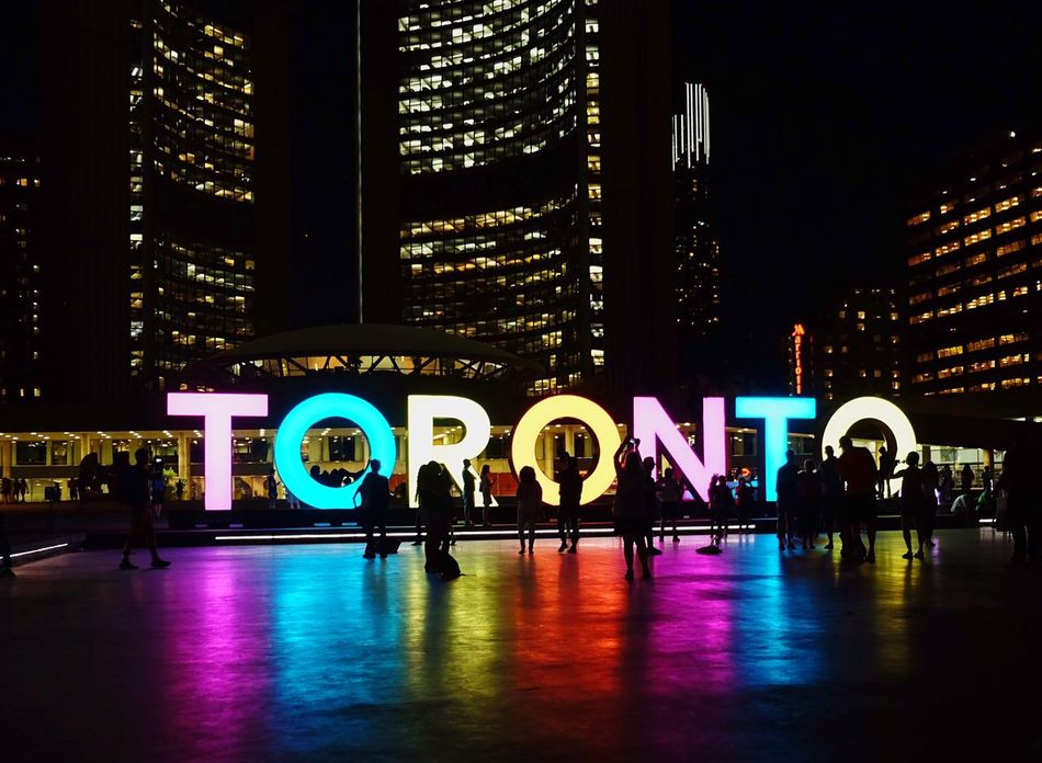 City at night Illuminated Night Reflection Built Structure Architecture Welcome To Black City Travel Destinations Modern Real People Skyscraper City Life Cityscape Urban Skyline Urban Landscape Neon Neon Lights Neon Sign Neon Color Toronto Toronto Canada Toronto Landscape Sign Signboard People