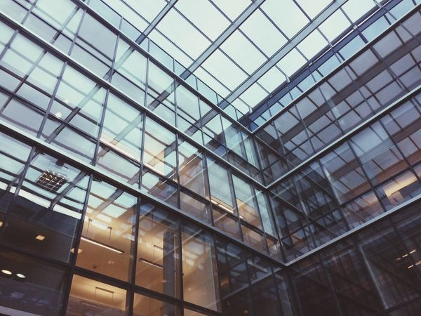 Glass - Material Architecture Window Built Structure Low Angle View Indoors  Modern Reflection No People Building Exterior Full Frame Day City Sky