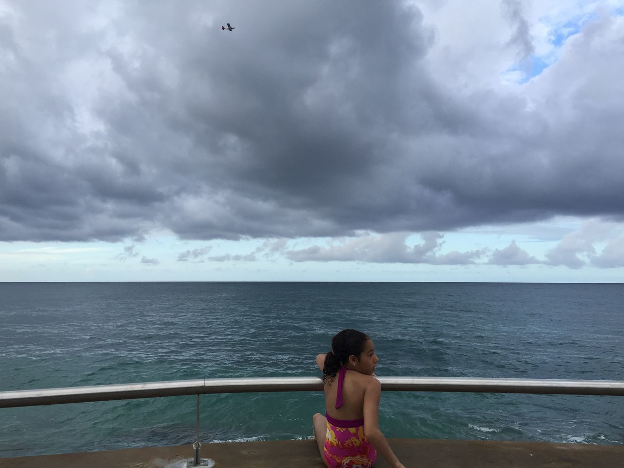 sea, sky, horizon over water, cloud - sky, water, railing, one person, nature, scenics, beauty in nature, outdoors, standing, real people, day, young adult, young women, people