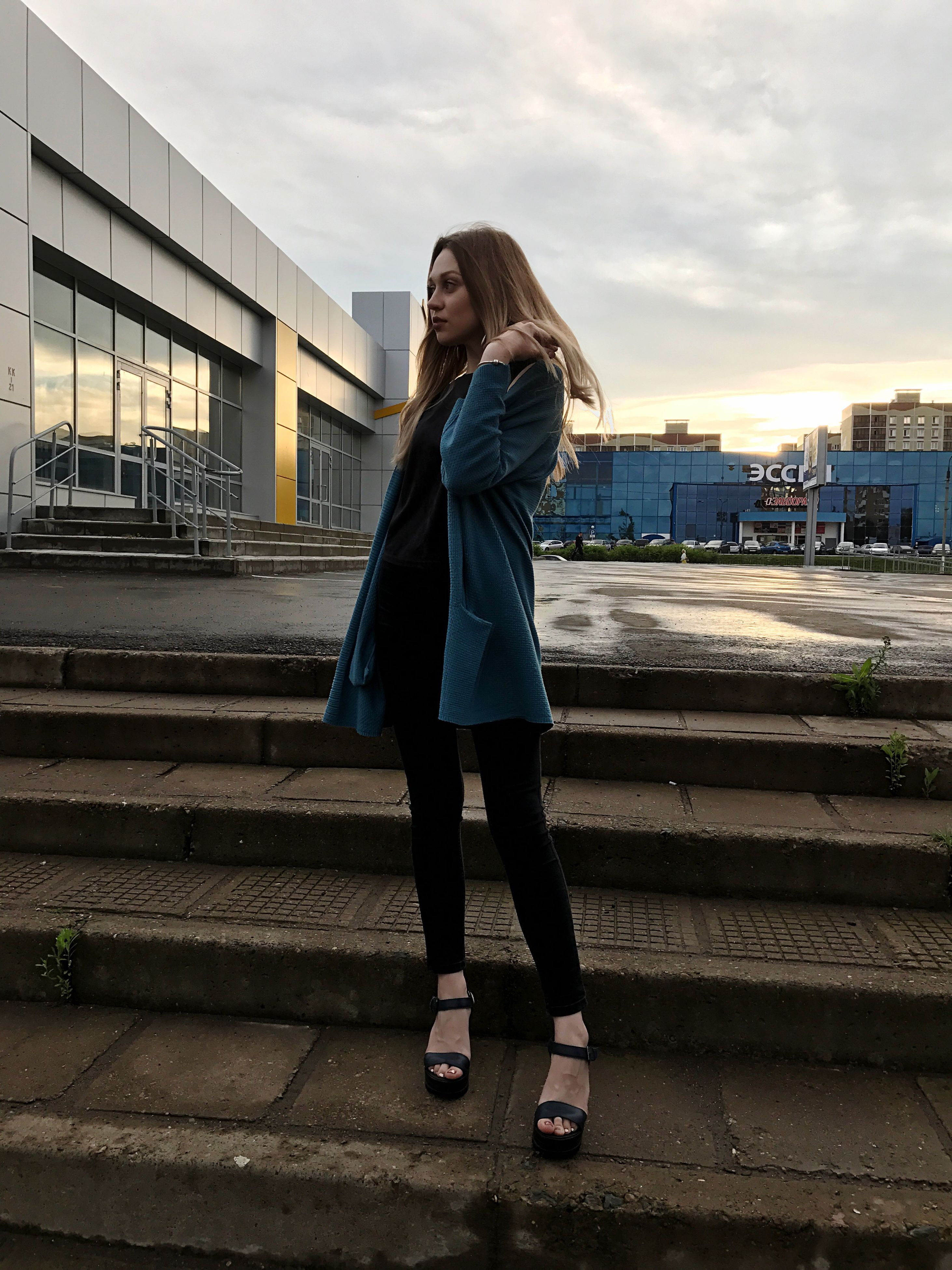 one person, full length, real people, built structure, architecture, young adult, outdoors, lifestyles, long hair, young women, leisure activity, building exterior, standing, beautiful woman, sky, sunset, city, women, day, smiling, portrait, nature