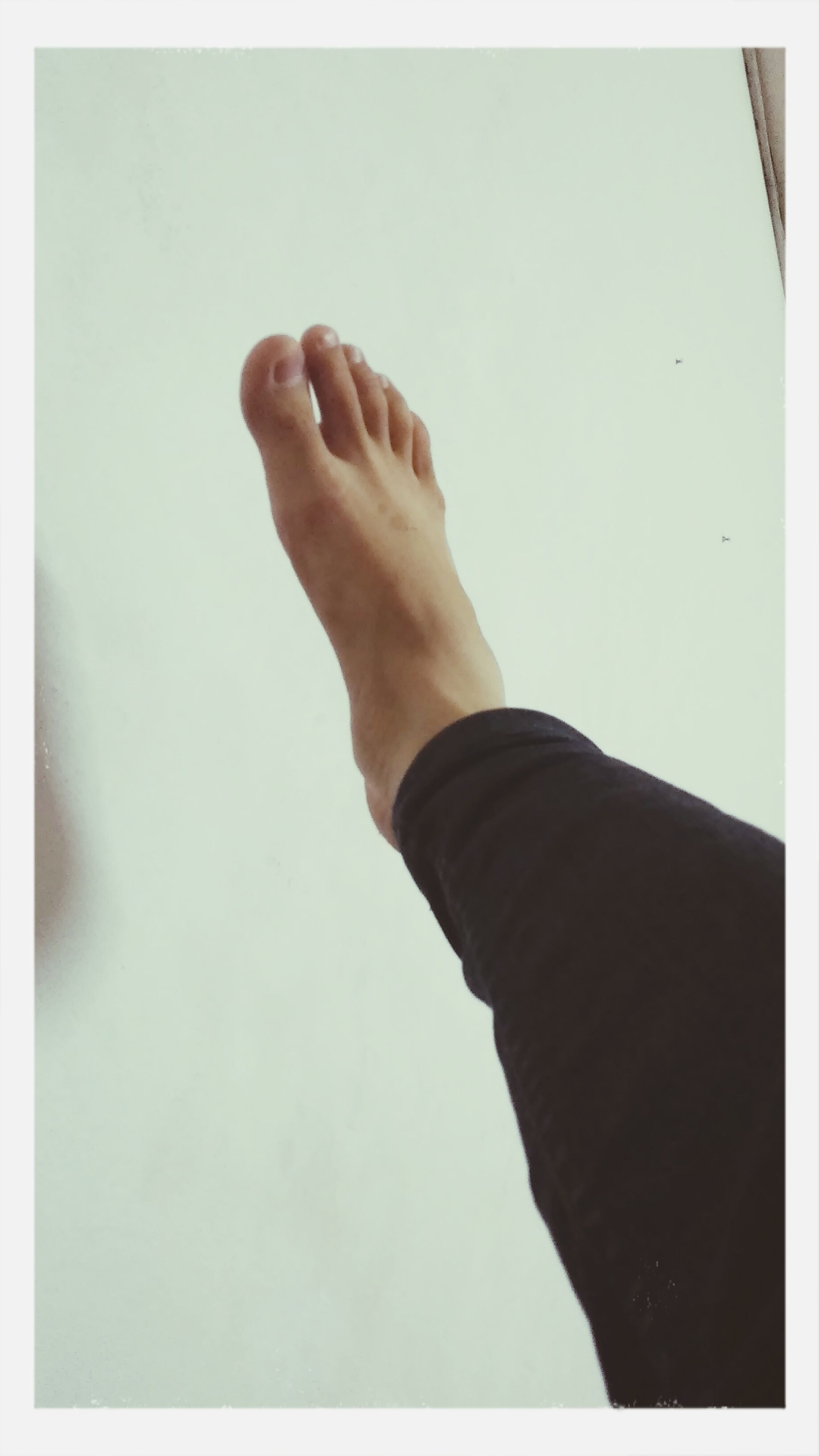 person, transfer print, lifestyles, low section, part of, personal perspective, auto post production filter, leisure activity, men, human finger, human foot, cropped, barefoot, copy space, indoors