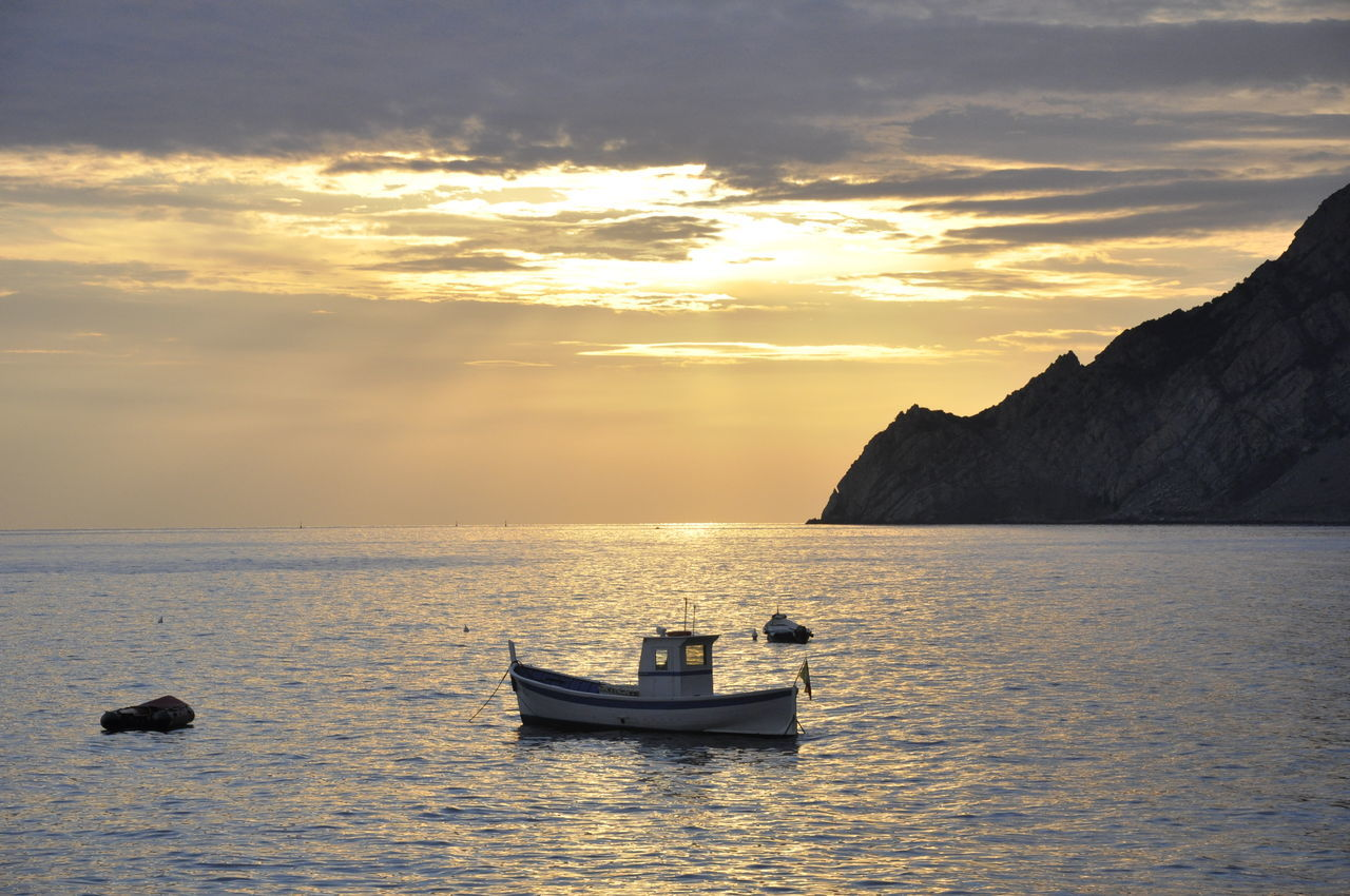 Beauty In Nature Boat Nature Nautical Vessel No People Outdoors Sea Sky Sunset Travel Destinations Water Loneliness Lonely Object Lonely Boat Calm Sea