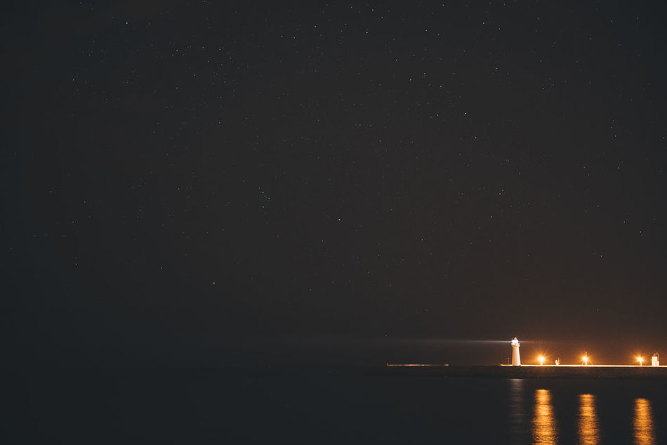 Donaghadee Lighthouse, Northern Ireland Astronomy Atmospheric Mood Bay Copy Space Donaghadee Irela Light Lighthouse Night Night Lights Northern Pier Seasunset SK  Star Star Field Starting A Trip