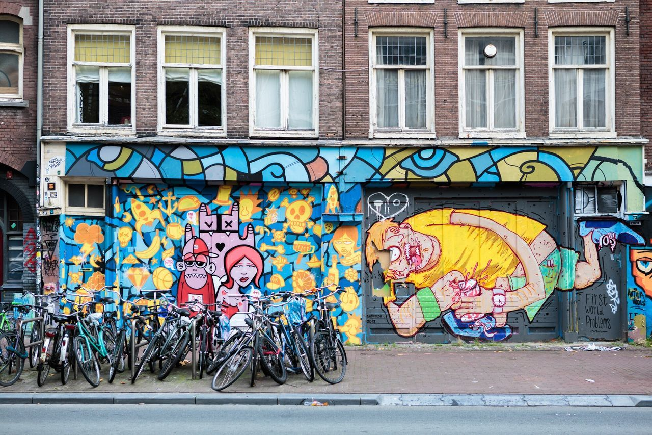 graffiti, street art, bicycle, architecture, creativity, built structure, building exterior, multi colored, day, outdoors, city, no people