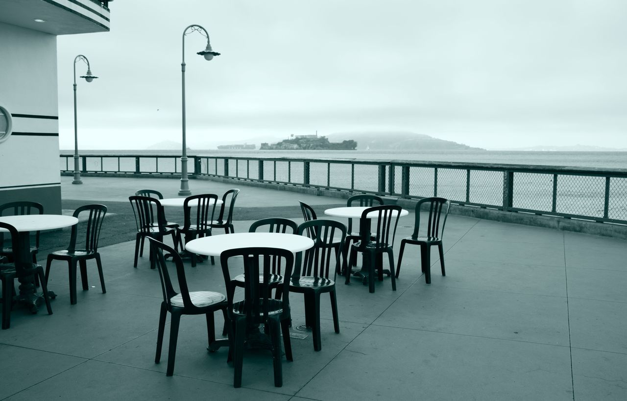 Deserted ,Alcatraz in the distance Alcatraz In View Alcatraz Island Art Nouveau Style Balcony View Black And White Style Cafe Chairs,tables Cloud - Sky Deserted Places Dinner Tables And Chairs Greyscale Moody Sky No People Outdoors Outside Cafe Prison San Francisco Stylish
