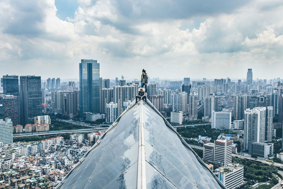 On the edge Architecture Built Structure Capital Cities  City City Life Cityscape Cloud Cloud - Sky Cloudy Day Guangzhou Modern No People Outdoors Reflection Residential District Rooftop Rooftops Sky Tall - High Travel Destinations Weather