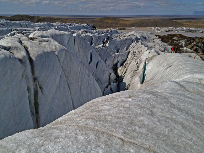 Glacier Vatnajokull iceland, climbers in the distance prepare to climb the glacier Edge Of The World