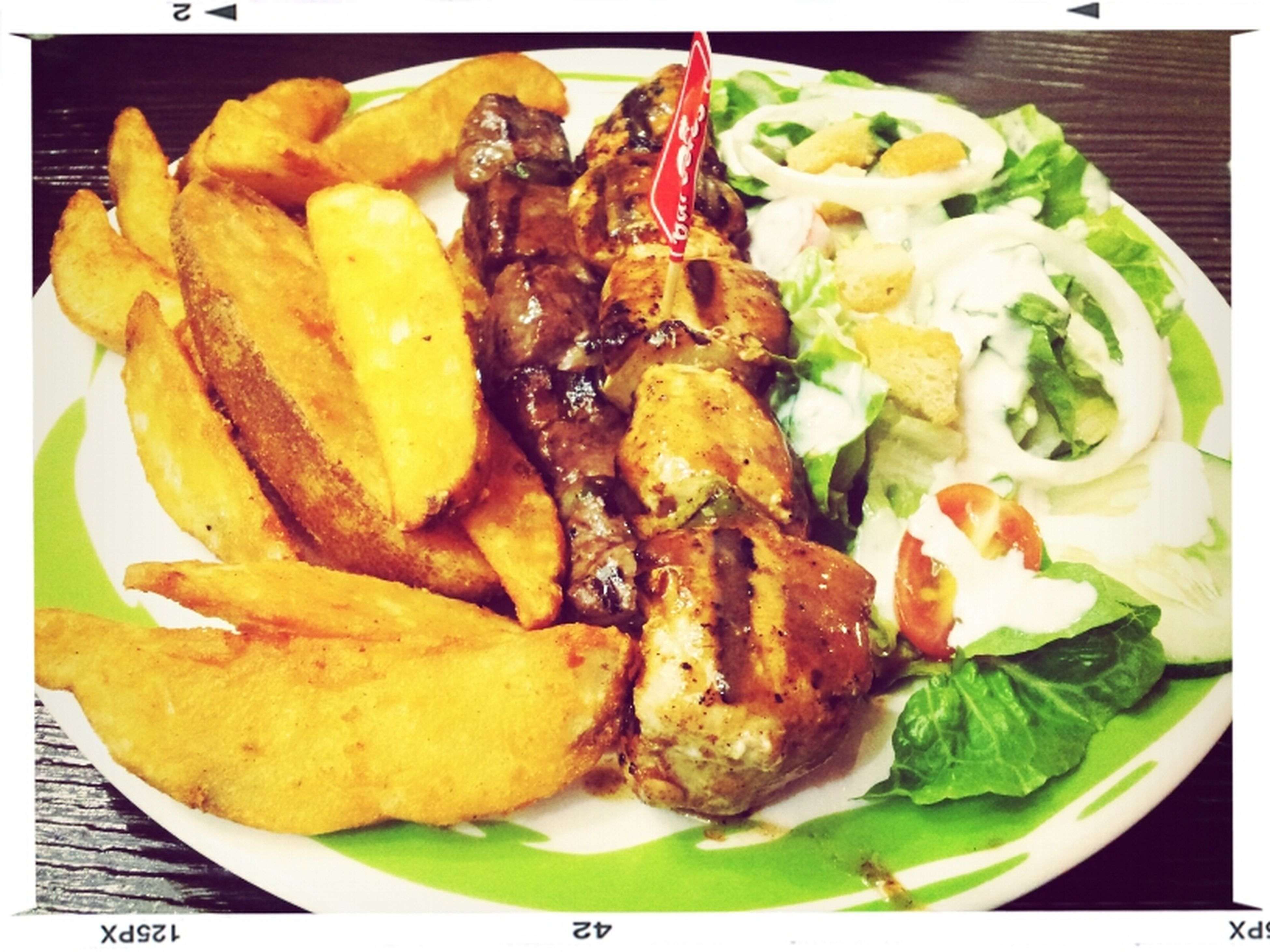 Mixed beef and chicken scewer in supa hot peri sauce with potato mojos and salad... Chilly Scewer Food